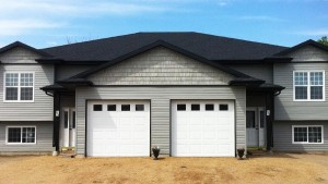 Duplex with vinyl Siding and Shakes